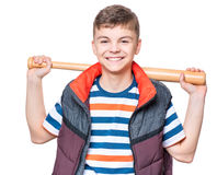 Teen boy with baseball bat. Portrait of a handsome boy teenager holding baseball bat. Funny cute smiling child looking at camera, isolated on white background Royalty Free Stock Image