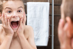 Teen boy in the bathroom Royalty Free Stock Image