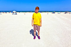 Teen boy at the beach in South Miami. Beachlife in south Miami with clear blue sky Royalty Free Stock Image