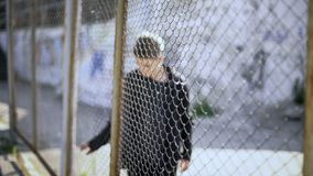 Free Teen Boy Behind Fence Confinement, Boarding School Restrictions, Broken Future Royalty Free Stock Image - 137530346