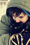Teen boy and black cat. Teen boy with a black cat, winter portrait Royalty Free Stock Photos
