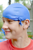 Teen Boy with Blue Balloon on Head royalty free stock images