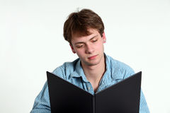 Teen boy with book. Handsome teen boy reading book Royalty Free Stock Photography