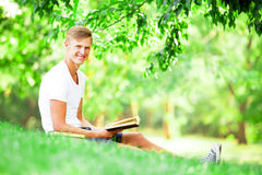 Teen boy with books Stock Image