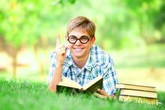 Teen boy with books Stock Photos