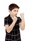 Teen boy boxer trains defence. Isilated on white Royalty Free Stock Image
