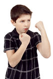 Teen boy boxer trains defence. Isilated on white Stock Photos