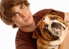 Teen boy and bulldog Stock Photography