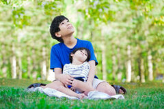 Teen boy caring for disabled brother Royalty Free Stock Images