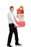 Teen boy carrying christmas presents Royalty Free Stock Images