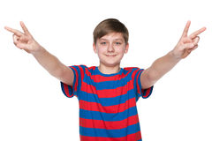 Teen boy celebrates victory Royalty Free Stock Photography