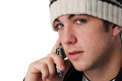 Teen boy on the cell phone. Isolated on a white background Royalty Free Stock Photo