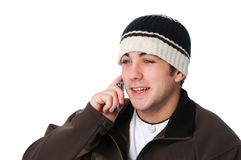Teen boy on the cell phone. Isolated on a white background Royalty Free Stock Image