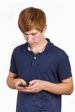 Teen boy checking his smart phone Stock Image