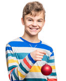 Teen boy with Christmas ball Royalty Free Stock Images