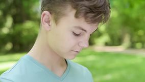 Teen boy in city park stock footage