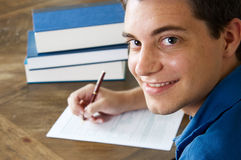 Teen boy with college application Royalty Free Stock Photography