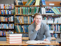 Teen boy in college library Stock Photo