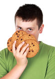 Teen boy with cookies royalty free stock photography
