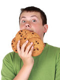 Teen boy with cookies royalty free stock photo