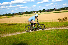 Teen boy cycling with his moutain bike Stock Photo