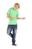 Teen boy dancing. With music isolated on white Royalty Free Stock Photos