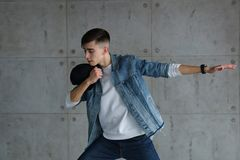 Teen boy dancing hip-hop with baseball cap Royalty Free Stock Image