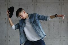 Teen boy dancing hip-hop with baseball cap Royalty Free Stock Images