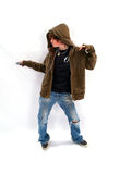 Teen Boy Dancing with MP3. Teenage boy listening to a MP3 player and dancing Royalty Free Stock Image
