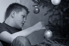Teen Boy Decorating Christmas Tree Royalty Free Stock Photo