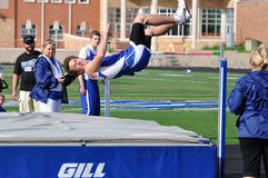 Teen Boy Doing the High Jump at Track Meet Stock Images