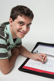 Teen boy doing homwork Stock Image