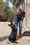 Teen boy doing some basic training with dog. Teen boy doing some basic training with his dog stock image