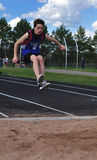 Teen Boy doing the Triple Jump Royalty Free Stock Photos