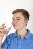 Teen boy drinks water Royalty Free Stock Photos