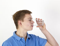 Teen boy drinks water Stock Photos