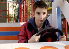The teen boy is driving Royalty Free Stock Image