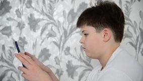 Teen boy enjoys  tablet indoors stock footage