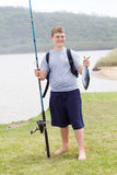 Teen boy fishing Stock Photos