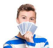 Teen boy with gamble cards. Close up portrait of caucasian teen boy with gamble cards. Handsome guy showing collect cards. Funny cut teenager playing, isolated stock image