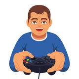 Teen boy gaming with gamepad controller Royalty Free Stock Photo