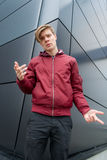 Teen boy gesticulating to express doubt about decision Royalty Free Stock Photography