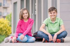 Teen boy and girl back to school. Happy children - boy and girl with backpack on the first or last school day - outdoor portrait. Excited to be back to school Stock Photos