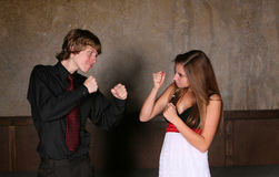 Teen boy and girl fighting Royalty Free Stock Photo