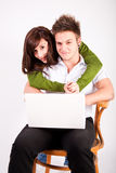 Teen boy and girl with laptop Stock Photo