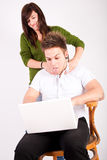 Teen boy and girl with laptop Royalty Free Stock Image