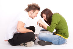 Teen boy and girl with laptop Stock Images