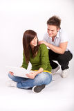 Teen boy and girl with laptop Stock Photos