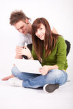 Teen boy and girl with laptop Royalty Free Stock Photos