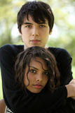 Teen boy and girl in outdoor portrait Stock Photography